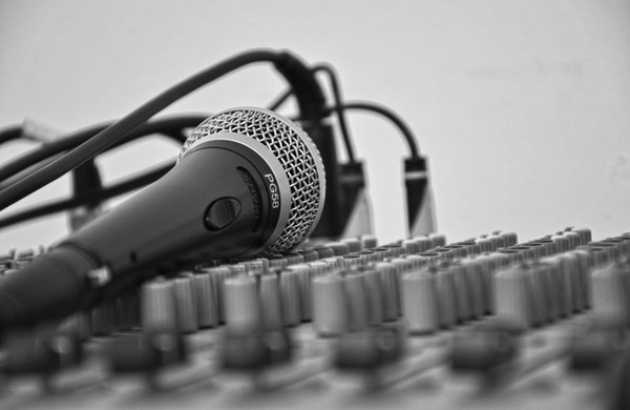 Microphone laying on a sound board.